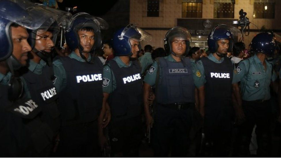 Police officers stand guard outside Dhaka's prison