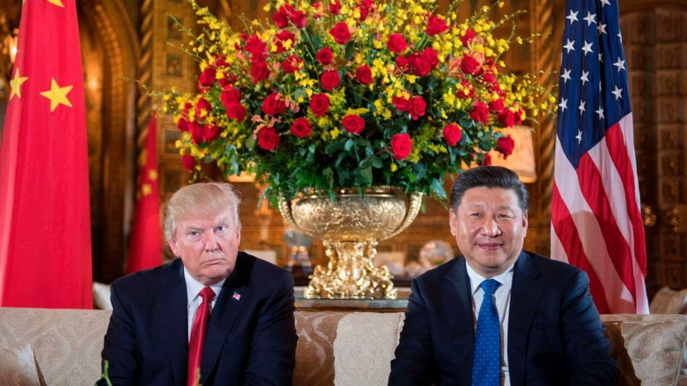 US President Donald Trump (L) sits with Chinese President Xi Jinping (R) during a bilateral meeting at the Mar-a-Lago estate in West Palm Beach, Florida, on April 6, 2017.