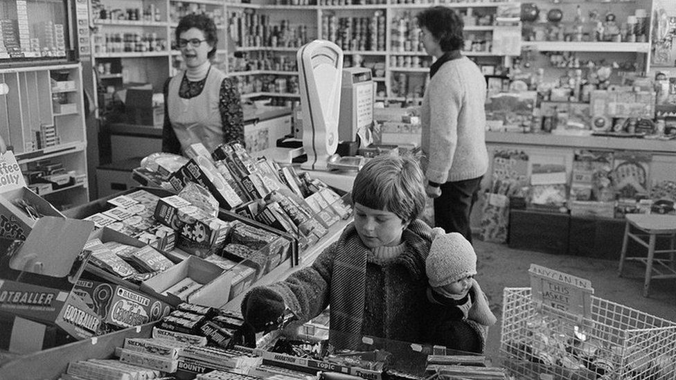 A village grocery stores with customers in Black Torrington, December 1979