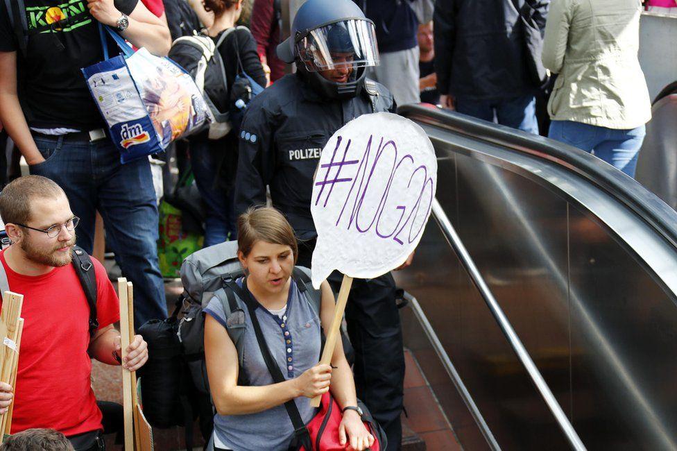 Activists arrive at Hamburg central railway station, 6 July