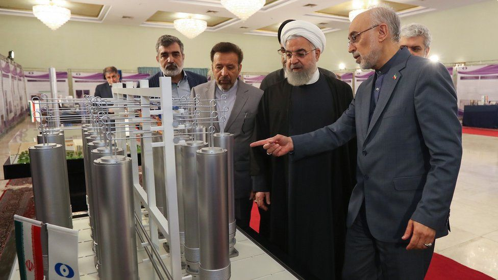 A handout photo showing Iranian President Hassan Rouhani (C) and the head of the Atomic Energy Organisation of Iran, Ali Akbar Salehi (R), inspecting nuclear technology in Tehran, Iran (9 April 2019)