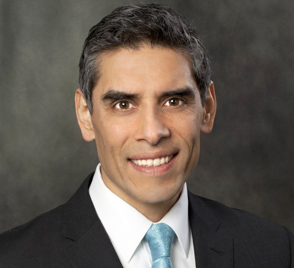 A head and shoulders picture of Jihad Shoshara, smiling and wearing a suit and tie
