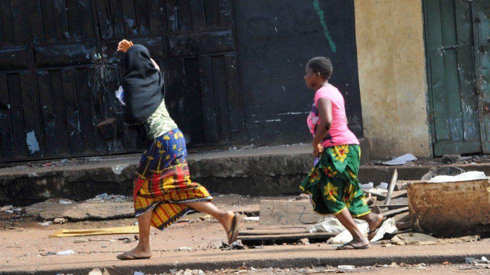 Two women run in pre-election clashes in Guinea