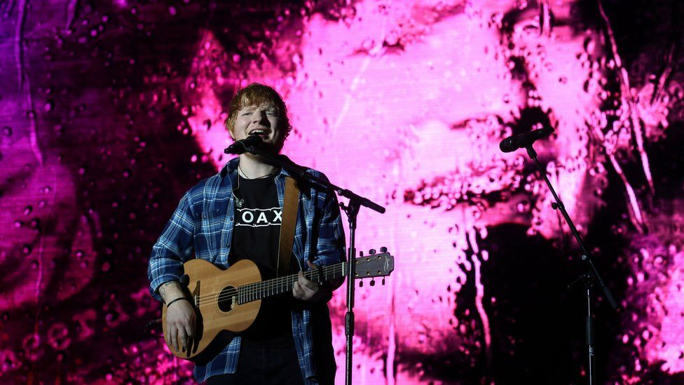 Ed Sheeran playing on stage