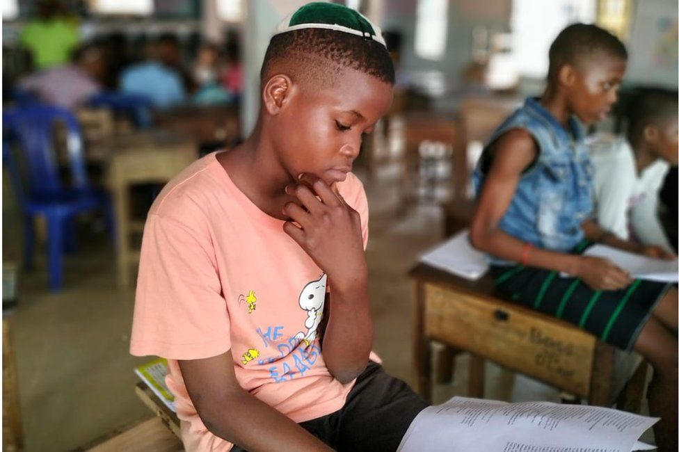 Igbo Jewish child studying in a religious class