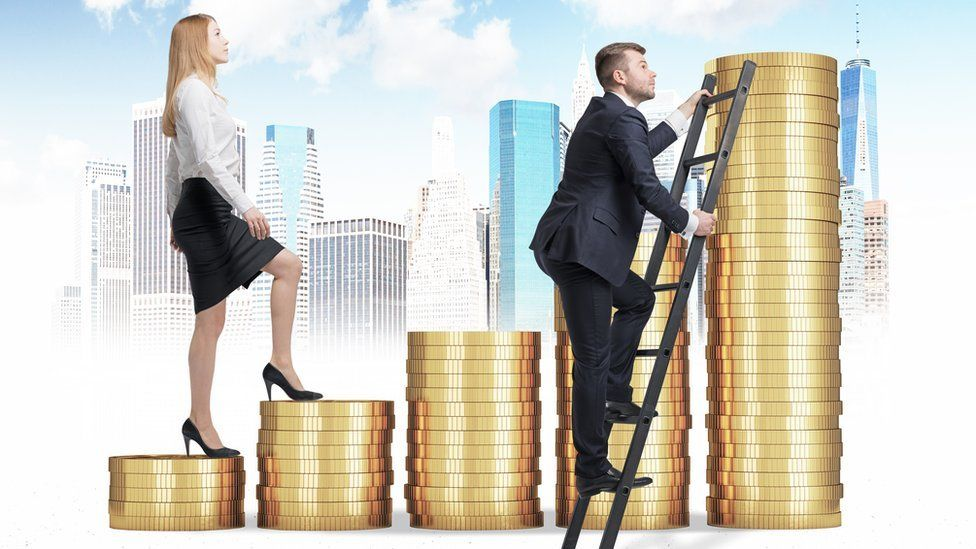 man and woman climbing piles of coins