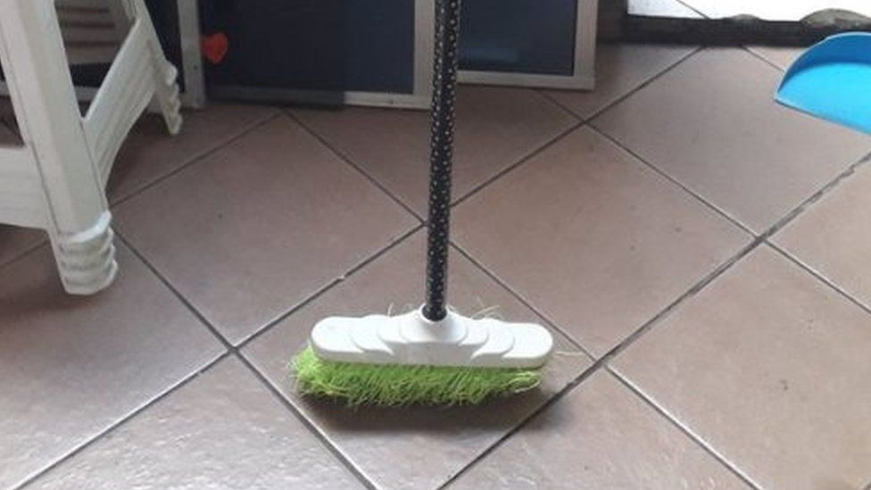 Broom standing upright