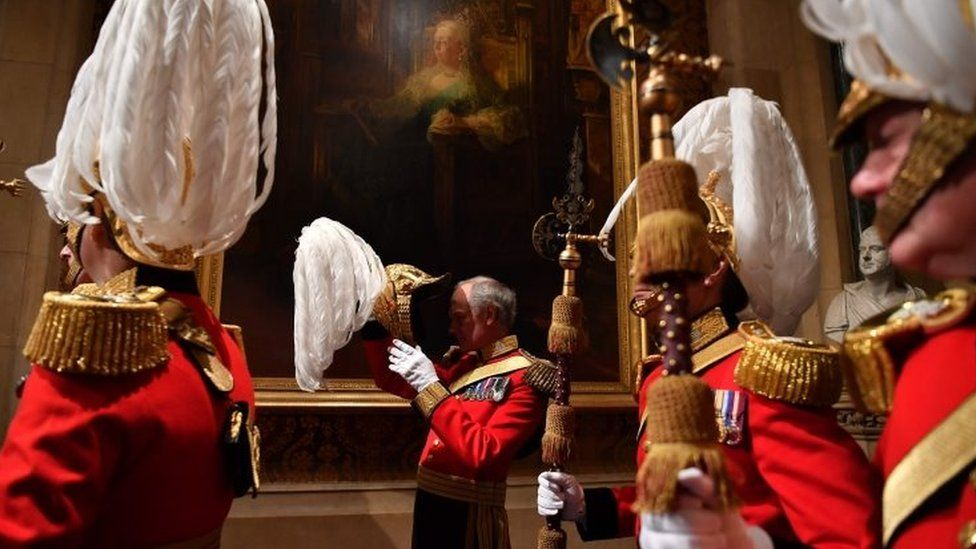 Gentlemen at Arms prepare for the arrival of the Queen at the Norman Porch during the State Opening of Parliament