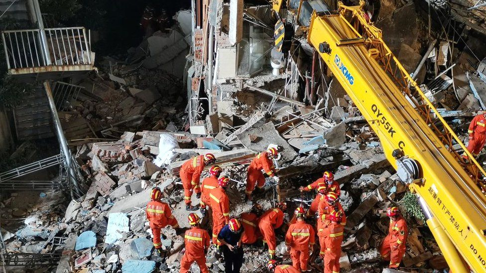 This photo taken on July 12, 2021 shows rescuers searching at the site of a hotel