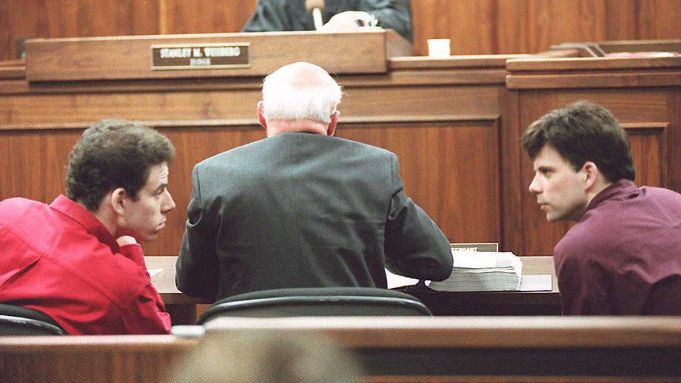 The brothers confer during their 1995 trial