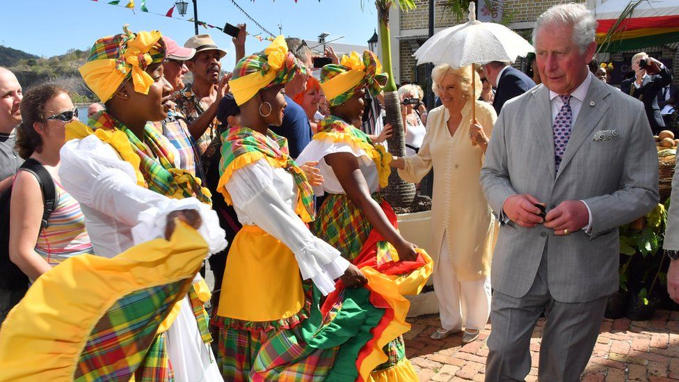 Prince Charles and Camilla visit a market during their visit to Grenada
