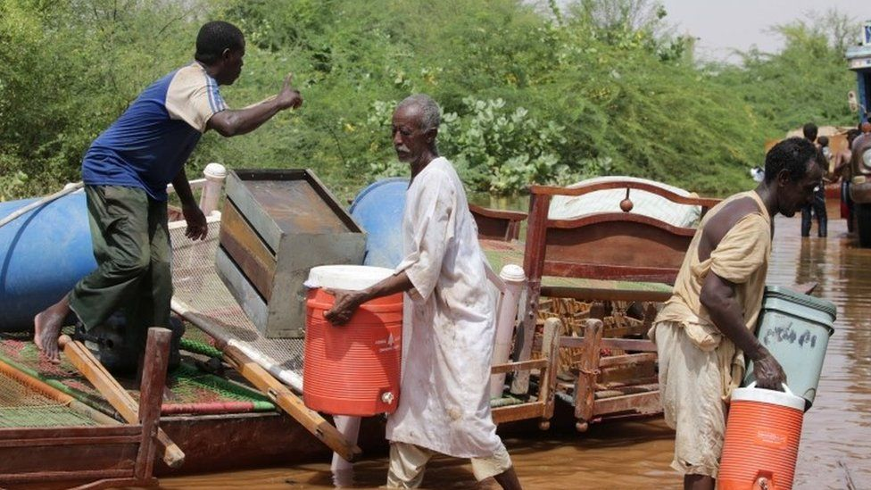 Residents load items they salvaged from their village onto trucks following heaving floods in Wad Ramli, some 45 km north of Khartoum, Sudan, 25 August 2019.