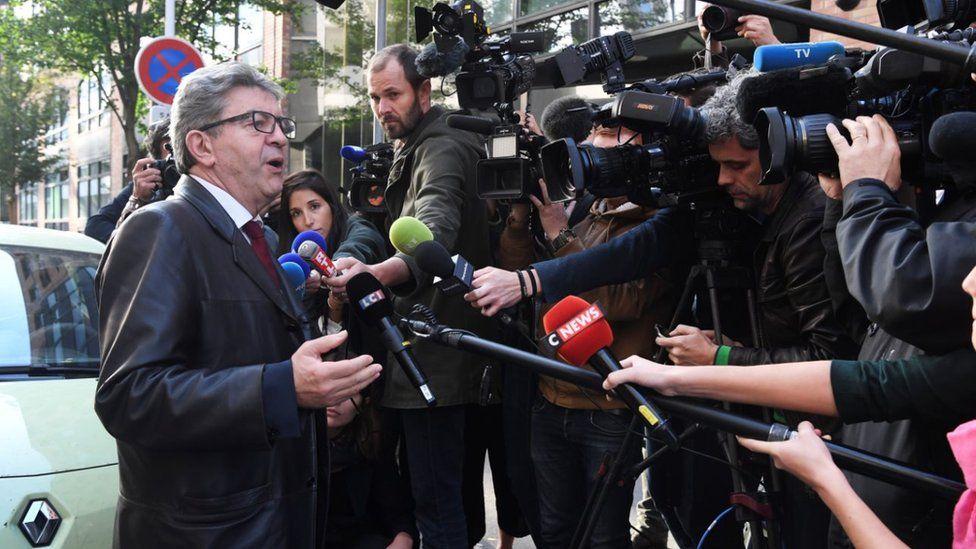 Jean-Luc Mélenchon speaks to reporters in October 2018