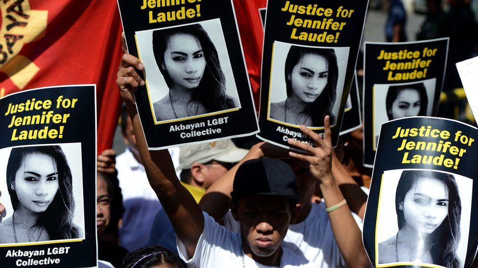 Supporters of the late Jennifer Laude hold up her image during a protest near a Philippine court in Olongapo, north of Manila on February 23, 2015