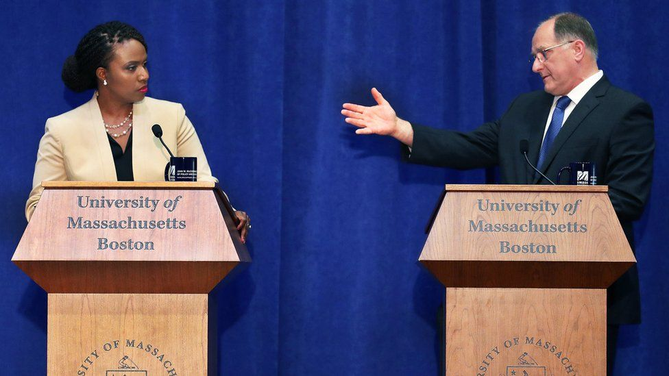Challenger Ayanna Pressley, left, and incumbent Michael Capuano take part in a debate