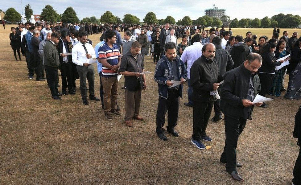 Mourners queue to see the open coffins on Winn's Common