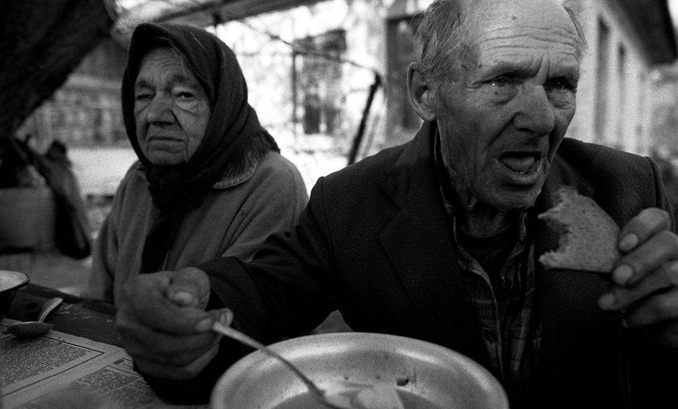 Maria and Ivan Semieniuk having supper
