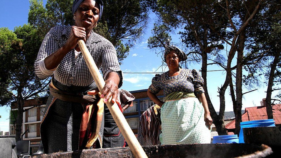 South African women prepare large quantities of traditional beer (umqombothi) for the African National Council's 100th anniversary on January 4, 2012, in Bloemfontein, South Africa.