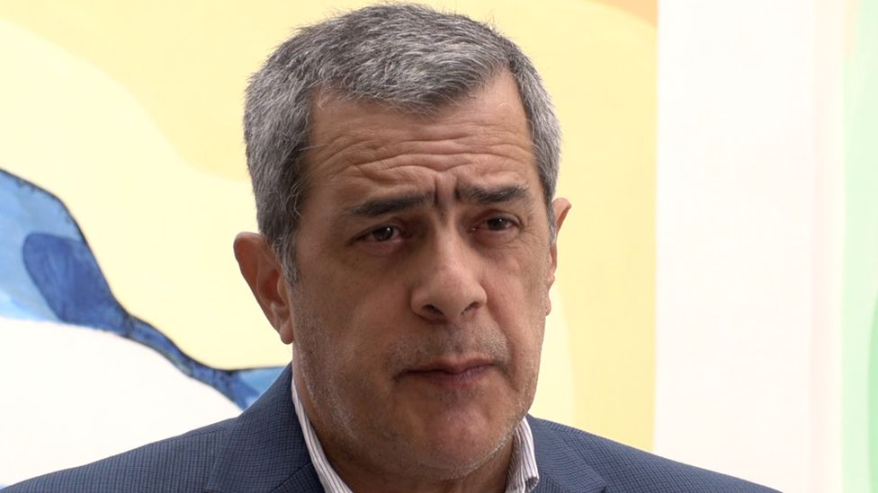 Dr José Moya speaks at a news conference in Havana