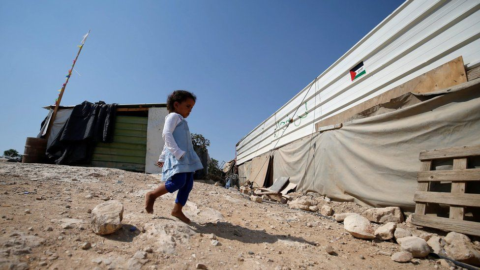 A girl walks outside her home in the Bedouin village of Khan al-Ahmar, in the occupied West Bank (5 September 2018)