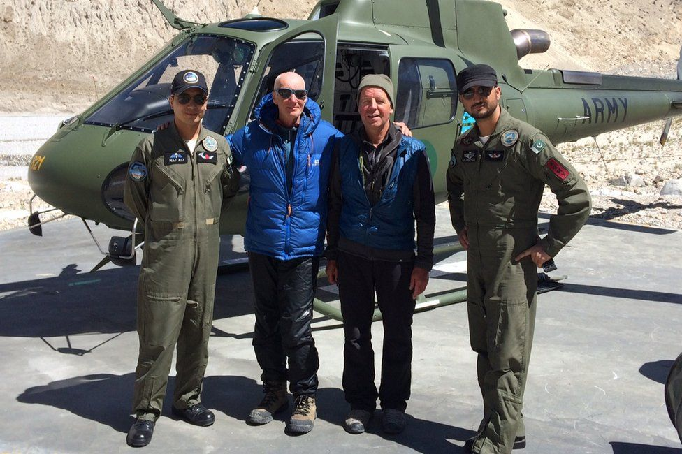 Rick Allen, in blue jacket, and Sandy Allan with helicopter crew after Mr Allen's rescue
