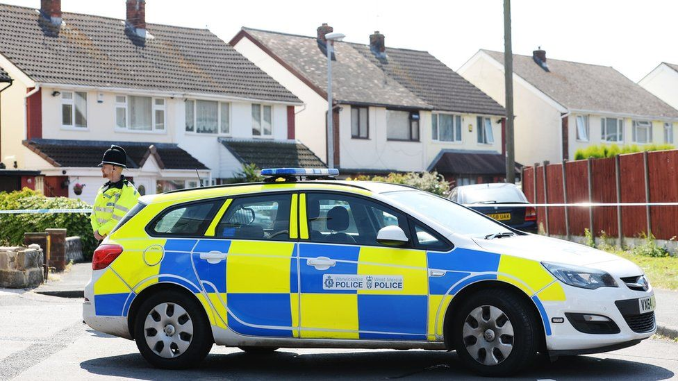 Police officer and car in Meadow Close