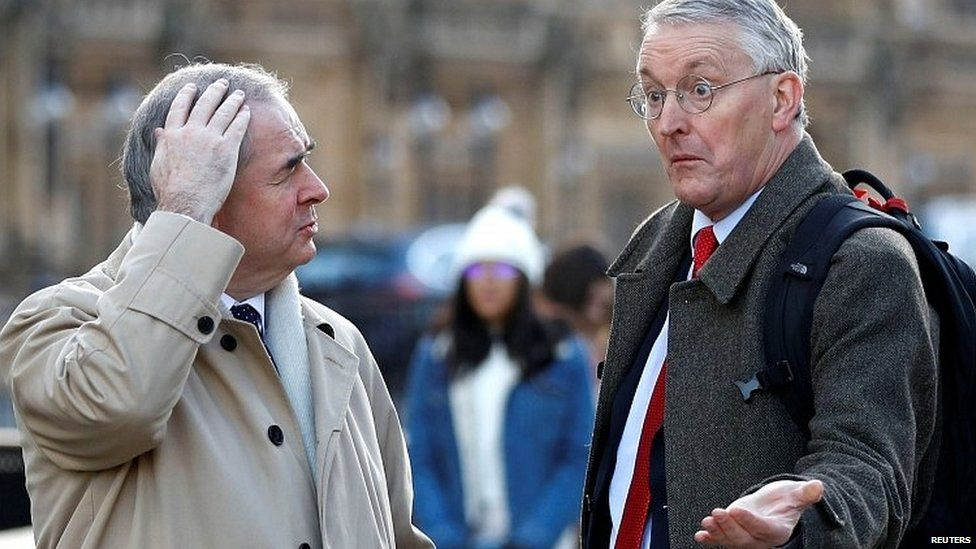 Attorney General Geoffrey Cox talking to Labour MP Hilary Benn outside Parliament