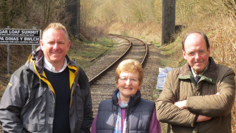 Sugar Loaf Station adopters Peter and Margaret Joyce with former BBC presenter Jamie Owen