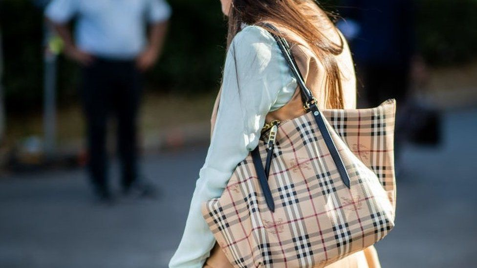 Lady wearing Burberry bag