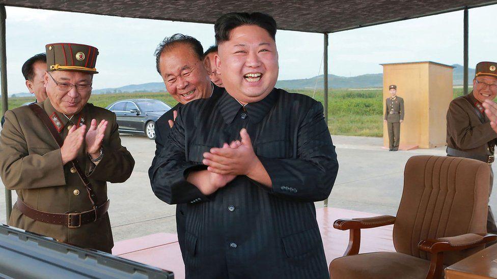 North Korean leader Kim Jong-Un inspecting a launching drill of A medium-and-long range strategic ballistic rocket