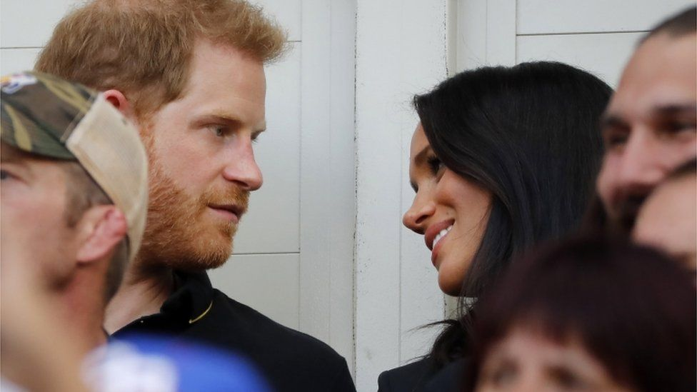 Prince Harry and wife Meghan in the stadium during the game