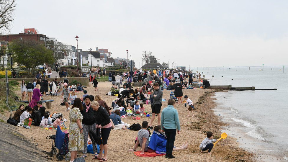 People enjoy the weather on Chalkwell beach, Southend, Essex. Picture date: Wednesday March 31, 2021.
