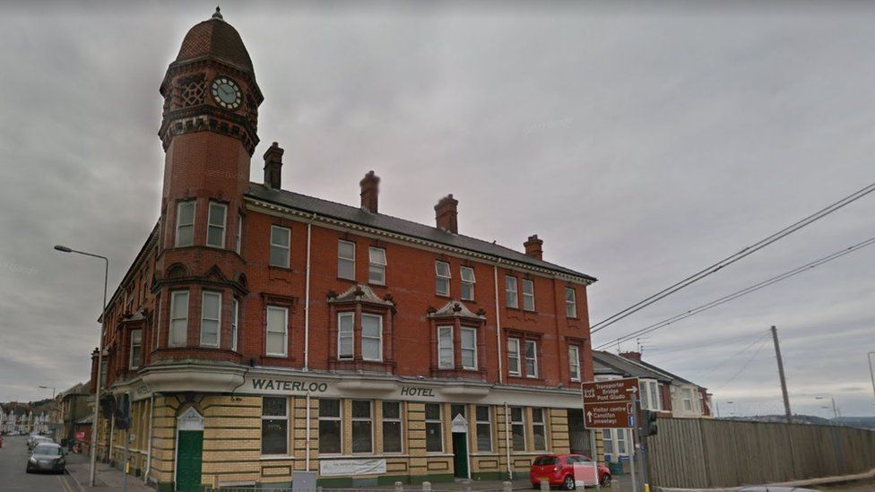 A photo of the Waterloo Hotel in Newport - which is a three storey red bricked building. The photo is taken an overcast day