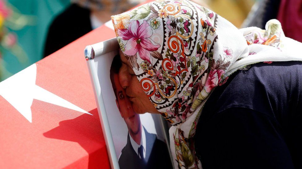 Relatives of Umut Sakaroglu, a custom officer at Ataturk Airport who was killed in the attacks on 28 June, mourn during a funeral in Istanbul, Turkey, 29 June 2016.