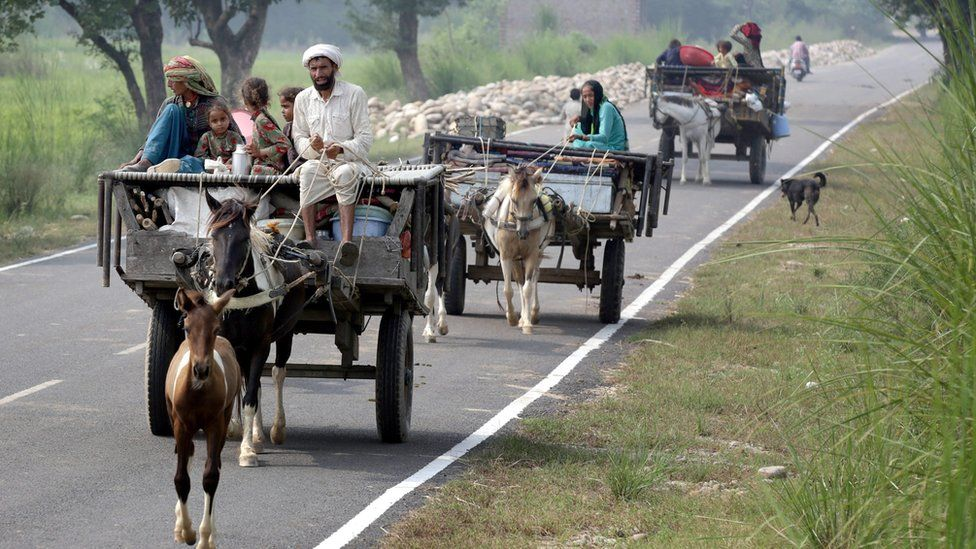 Indian border villagers travel in a cart as they move with their belongings to a safer place after authorities ordered the evacuation of villages near the Pakistan border, at Paloora village, about 55km from Jammu, the winter capital of Kashmir, India, 30 September 2016
