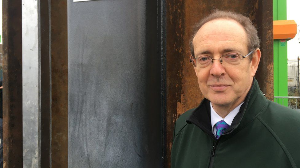 Close up of Sir James Bevan, the head of the Environment Agency, looking at the camera in Great Yarmouth in December 2016