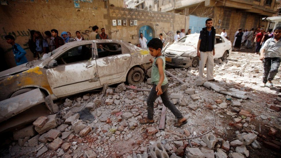 People at the site of an air strike launched by the Saudi-led coalition in Sanaa, Yemen May 16, 2019.