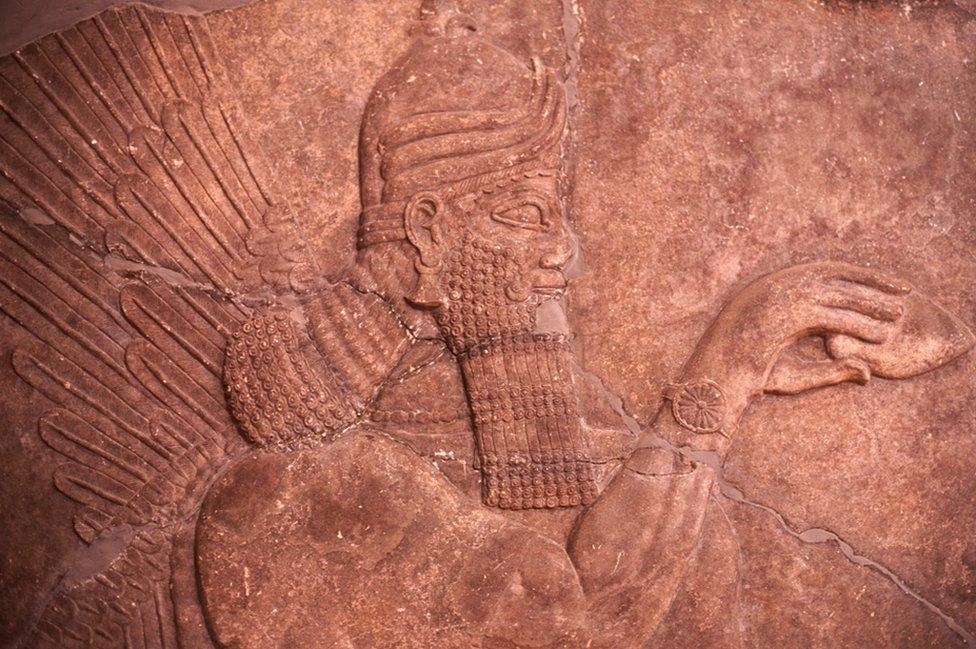Carved face of a genie from Nimrud