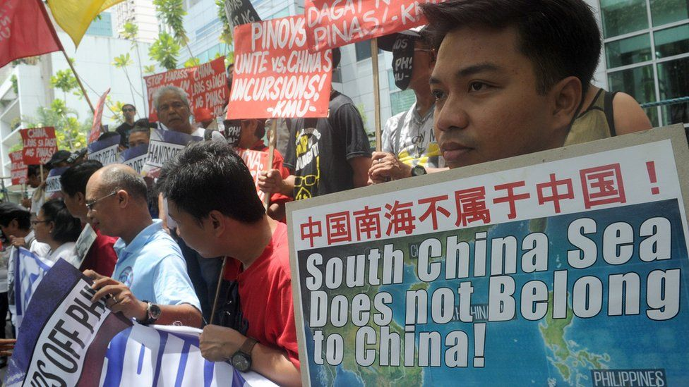 Protesters with placards at a rally in front of the Chinese Consulate in Manila's financial district, denouncing China's claim to most of the South China Sea