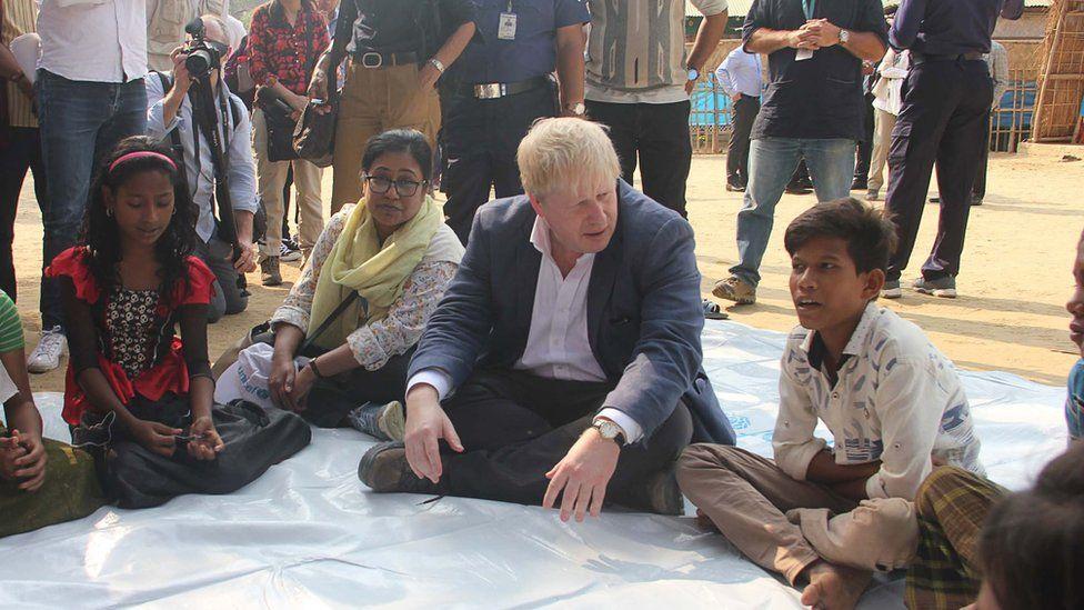Boris Johnson with refugees