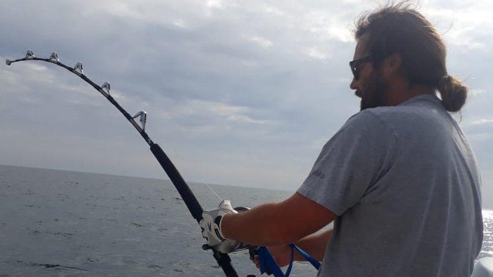 Rik Le Ray reeling in an Atlantic bluefin tuna off Guernsey