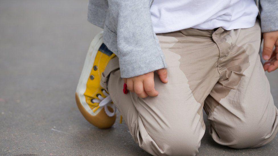 Boy with wet crotch
