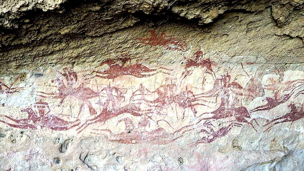 Horses and riders depicted in a cave painting in Ennedi