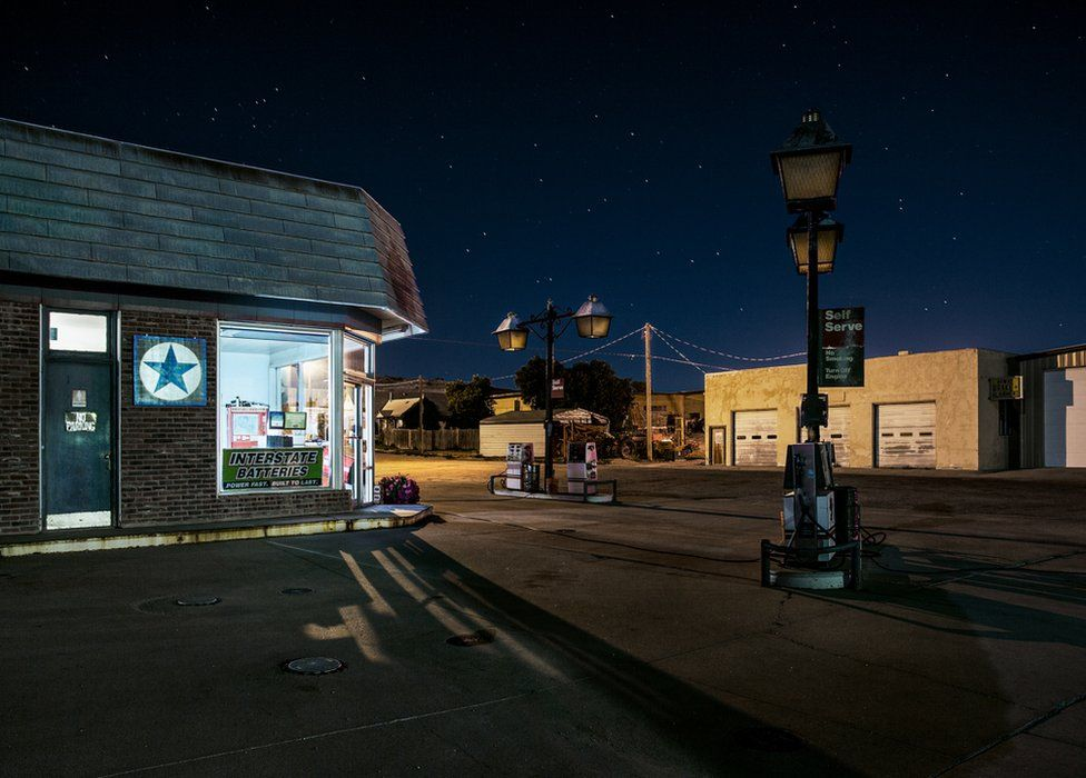 A night view of a shop, a night sky full of stars above