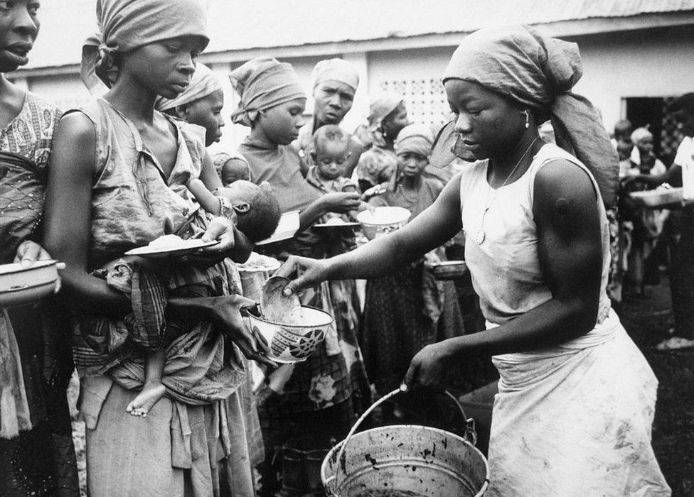 BIAFRA- By all military odds, Biafra should have lost its war with federal Nigeria long ago. It has not lost, but in the next few months it might--vanquished by starvation. Here, women and children receive their meager rations at a refugee camp.