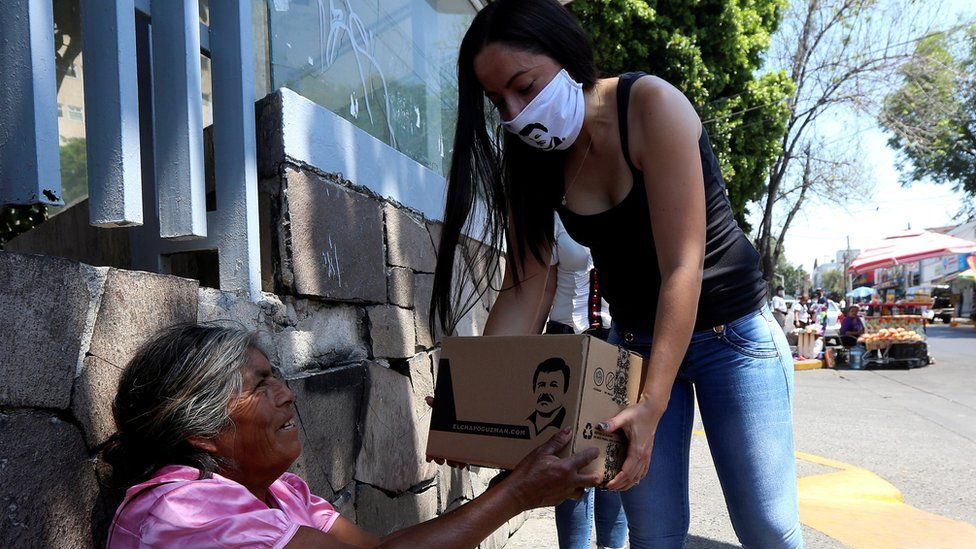 Woman hands out food parcels on behalf of the clothing company owned by El Chapo Guzman's daughter