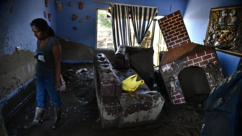 A woman observes her house after a flooding of La Paila river in the municipality of Corinto, Department of Cauca, Colombia, 08 November 2017.