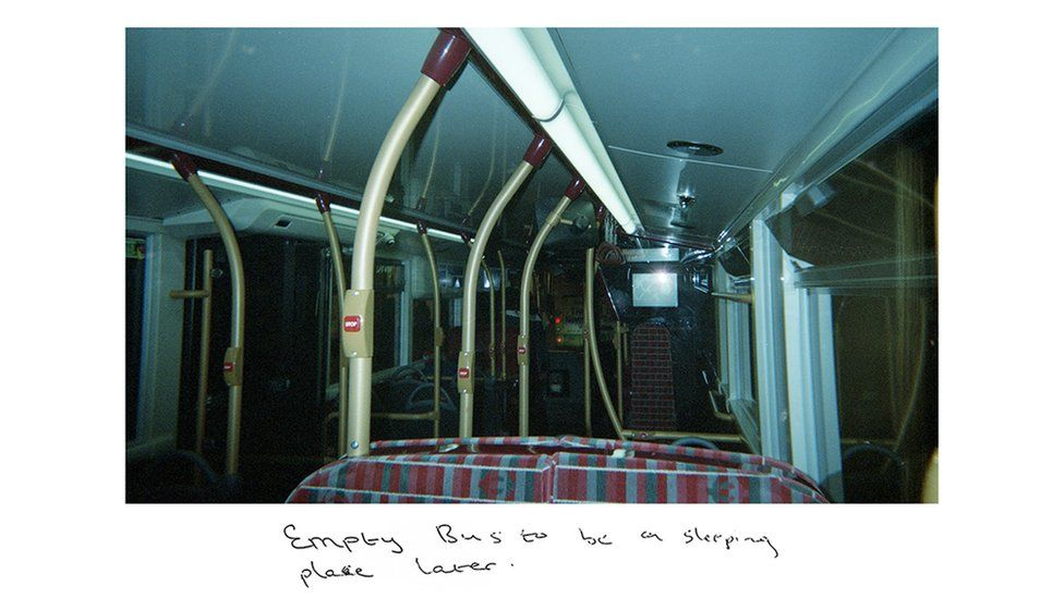 "Sunny's image of the empty lower dock of a bus, with the handwritten title: ""Empty bus to be a sleeping place later."""