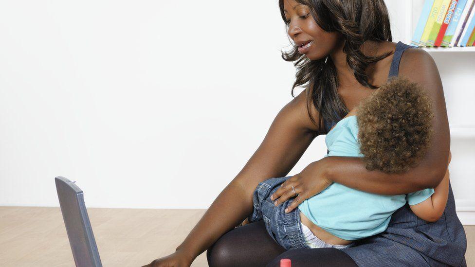Woman breastfeeding while working