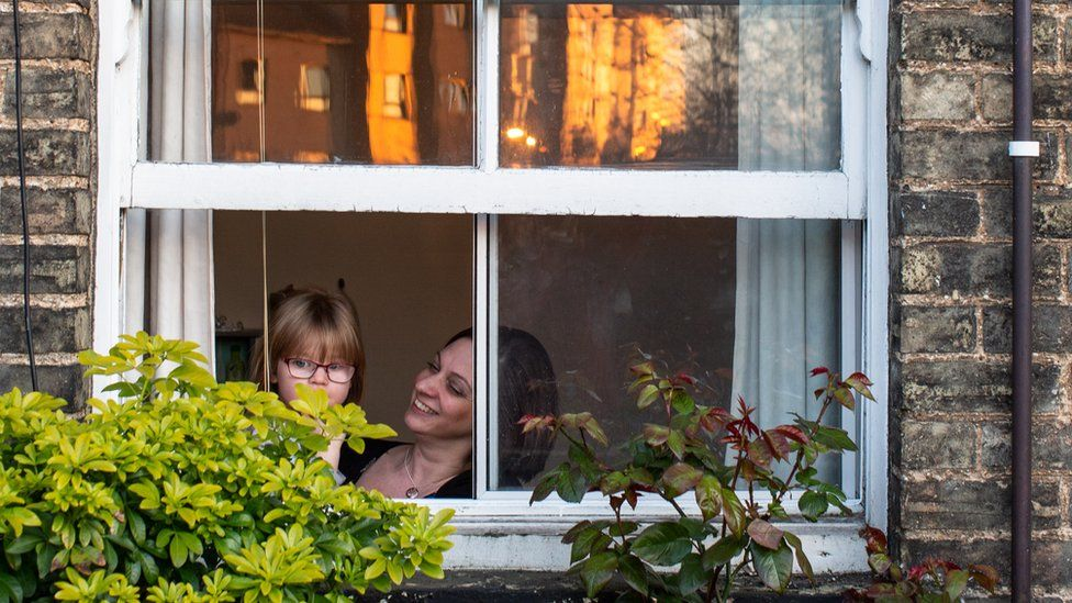 Family at a window